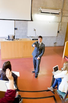 Charismatic teacher giving a lesson to university students