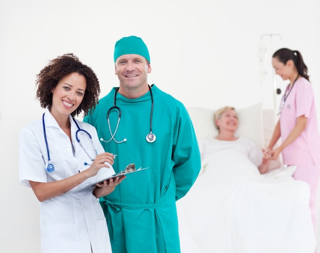 Charismatic team of doctors smiling at camera