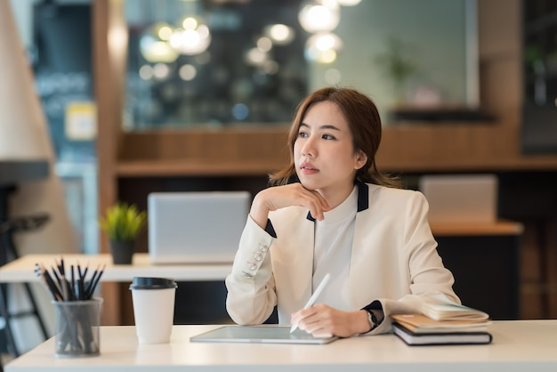 Charming asian businesswoman working concept using tablet office.