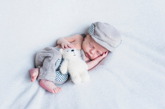 Charming baby with toy
