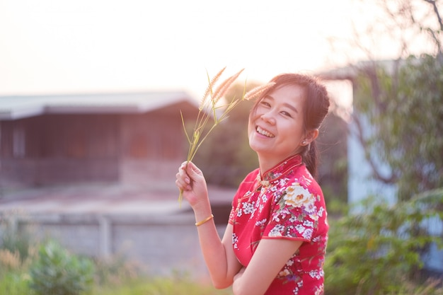 Charming beautiful asian woman standing and smiling