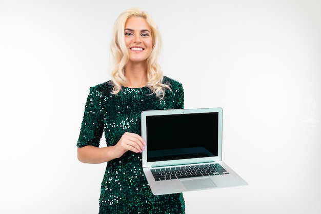 Charming blond lady demonstrates a blank laptop screen on a white background with copy space