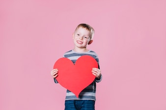 Charming boy with heart