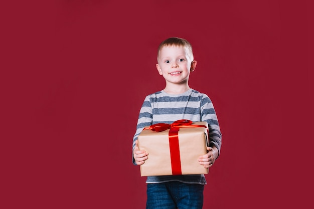 Charming boy with present
