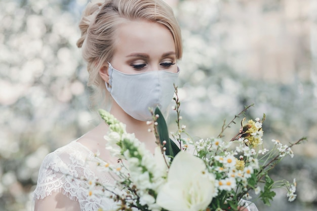 Charming bride in protective mask