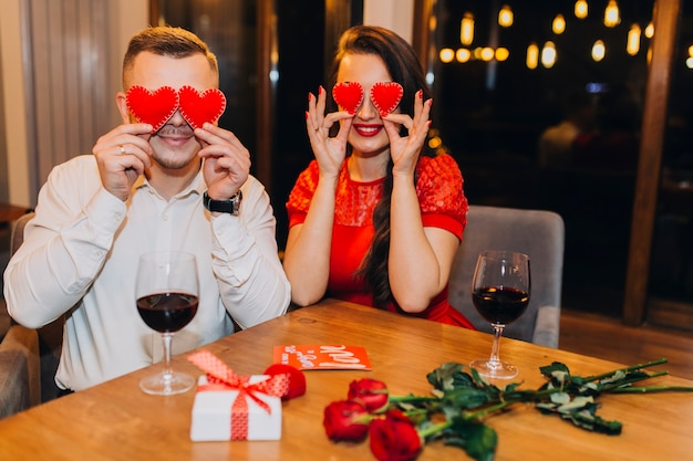 Charming couple posing playfully in cafe