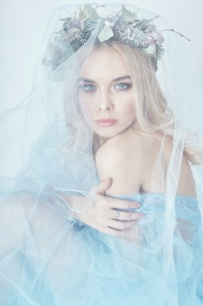 Charming fairy woman blue ethereal dress, wreath