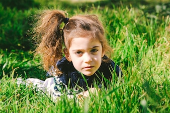 Charming girl in grass