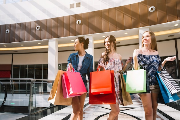 Charming girls doing purchases together