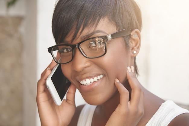 Charming latin woman talking on phone. closeup portrait