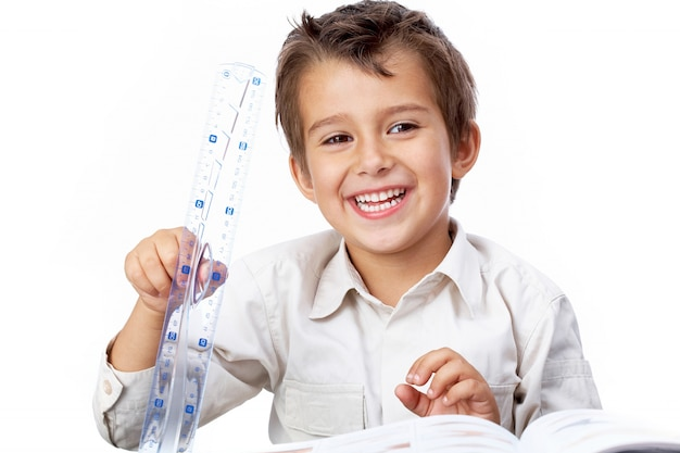 Charming little boy playing with the ruler