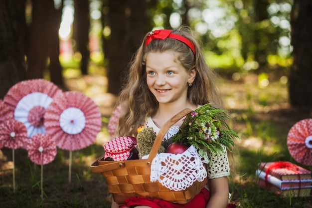 Charming little girl smiling holding a basket