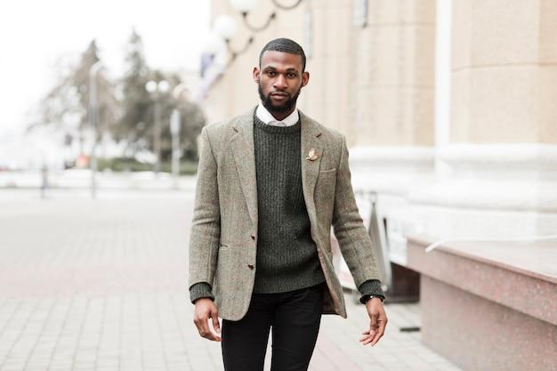 Charming man posing outside