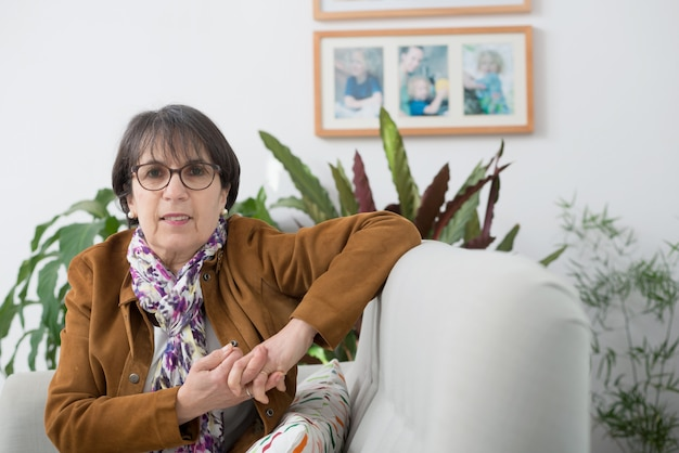 Charming mature woman with brown jacket and glasses
