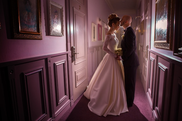 Charming portrait of just merried couple in violet tones