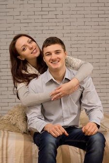 Charming smiling couple in an affectionate embrace