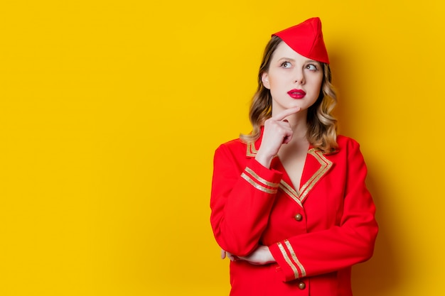 Charming vintage stewardess wearing in red uniform