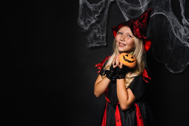 Charming witch with pumpkin
