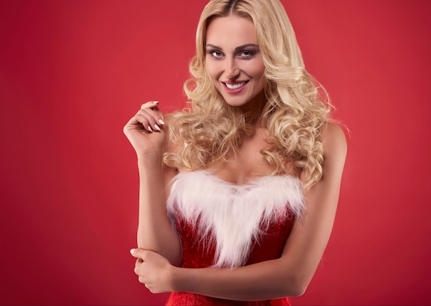 Charming woman dressed is santa disguise