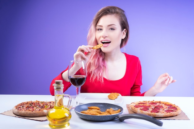 Charming woman eating a wedge of homemade potato