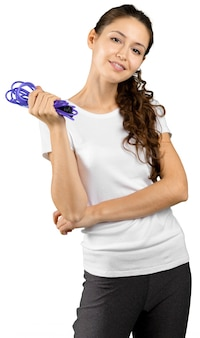 Charming woman holding skipping rope