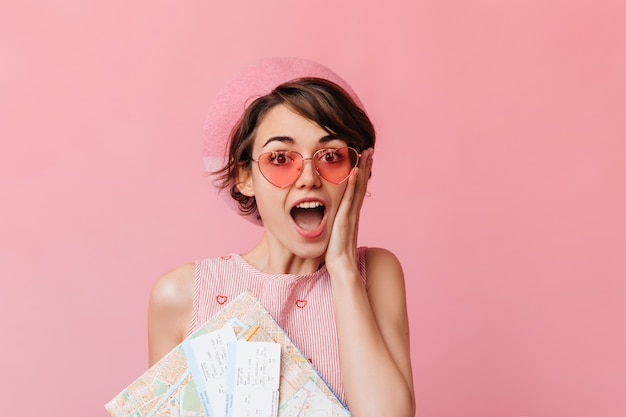 Charming woman in pink glasses waiting for travel