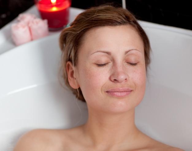 Charming woman relaxing in a bath