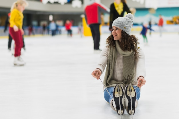 Charming woman sitting on ice