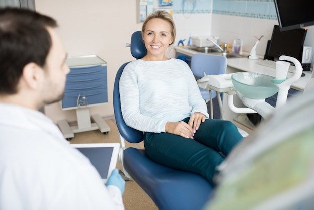 Charming woman visiting dentist