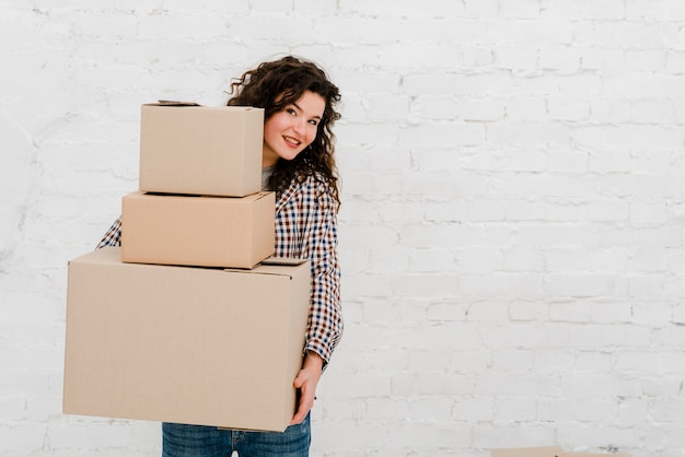 Charming woman with stack of boxes