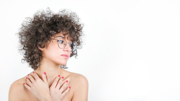 Charming young woman with curly hair wearing stylish spectacles