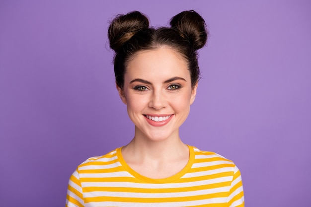 Charming youngster brunette lady with two buns top-knot hairstyle smile