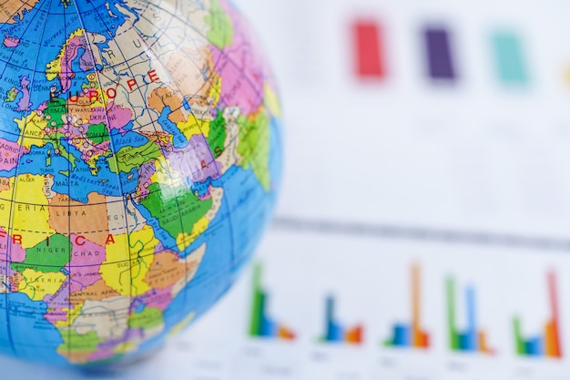 Chart graph paper with globe world europe map.