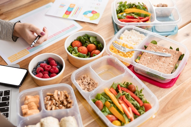 Charts and organic food in lunch boxes