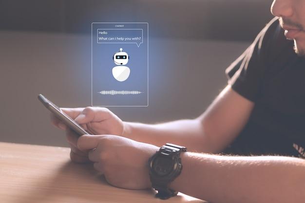 Концепция технологии искусственного интеллекта chatbot ai. руки человека, держа мобильный телефон