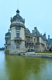 The chateau de chantilly (france). the grand chateau rebuilt in 1870 s (architect honore daumet).