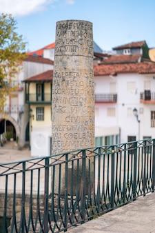 Chaves portugal roman inscription on a column touristic and historic landmark stone roman bridge