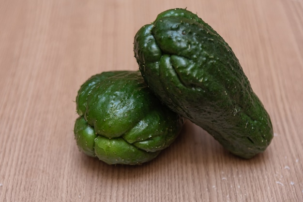 Chayote on wooden table