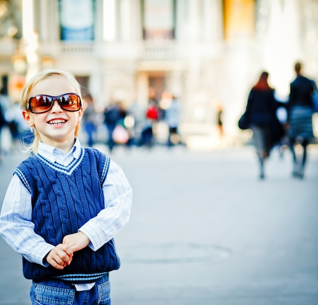 Check it out! that's a new me! little boy walks in mother's sunglasses