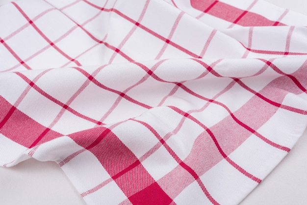 Checked tablecloth in a red and white cage