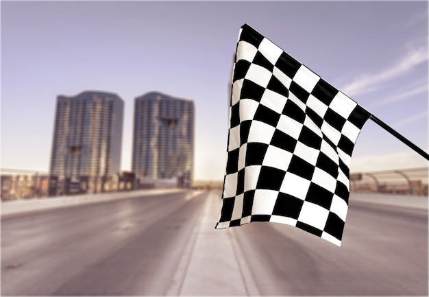 Checkered flag isolated on background. concept photo of winner