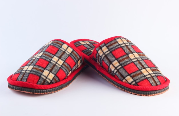 Checkered indoor slippers isolated on white.
