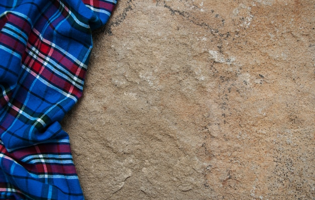 Checkered napkin on a stone surface