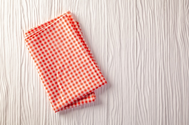 Checkered napkin on white table