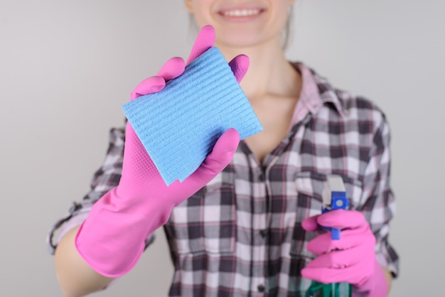 Checkered shirt housekeeping housecleaning person people microfiber duster camera concept. close up photo of lady's hands wiping transparent glass using sprayer isolated on gray background