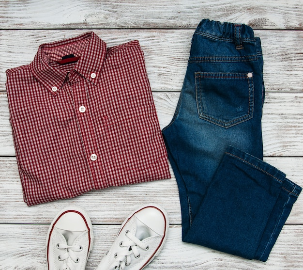 Checkered shirt and jeans