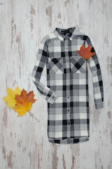 Checkered shirt and maple leaves. fashionable concept