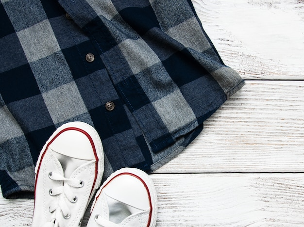 Checkered shirt with white sneakers