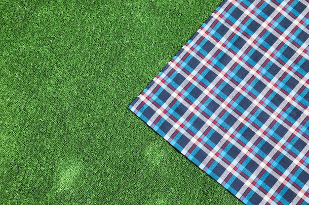 Checkered table cloth on green turf
