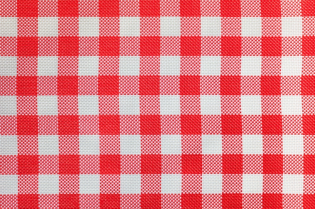 Checkered tablecloth for the table in red and white cells.
